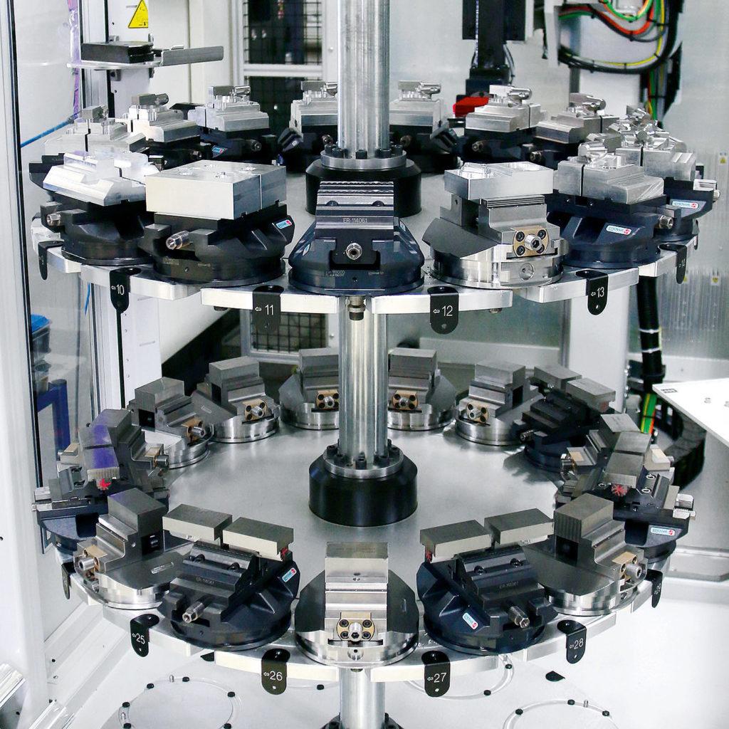 magasin robotisé remplis mandrins PowerChuck210 permettant le serrage de pièces complexes